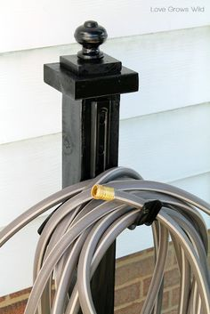 Make this DIY Garden Hose Holder to add great curb appeal to your home! | LoveGrowsWild.com