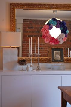 I can't believe I've never thought of making a tissue paper flower wreath! think I'll make this in rainbow colors for Lura's party, instead of a yarn one. It's made with a circle form cut out of cardboard, so it's super light and can be hung almost anywhere with just tape! (bonus: this blogger is so funny!)