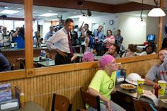 President Barack Obama talks with patrons as he waits for his lunch order during a stop at Skyline Chili in Cincinnati, Ohio, July 16, 2012.