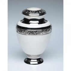 Elegant White Cremation Urn has creamy white finish with shiny silver engraved trim. White suggests purity, peace, and light.