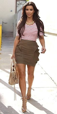 Pleated Skirt , Form Fitting tucked in top , Nude pumps , & Big Bag