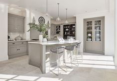 This stunning grey painted kitchen features a beautiful glazed pantry, Silestone worktops as well as Wolff, Westin and Neff appliances. Shaker Style Kitchens, Shaker Kitchen, Home Kitchens, Open Plan Kitchen, New Kitchen, Kitchen Decor, Kitchen Grey, Country Kitchen, Kitchen Furniture
