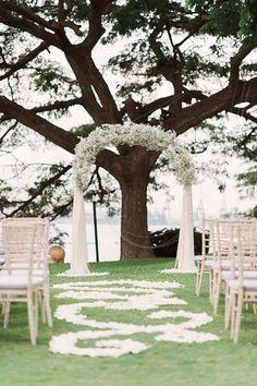 Baby's breath wedding arch and petal-filled aisle  / http://www.himisspuff.com/rustic-babys-breath-wedding-ideas/3/
