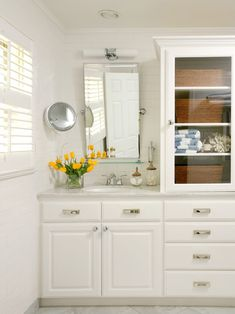 Tobi Fairley: Custom vanity and bathroom storage with drawers and glass front cabinet. Pivot style ...
