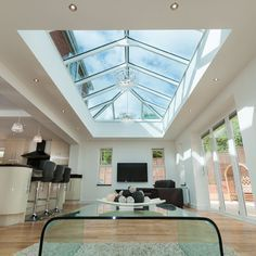 Aluminium roof lantern, skylight and flat roof skylight are all terms used to describe a glazed structure constructed within a flat roof system. Our aluminium Flat Roof Systems, Roofing Systems, Orangerie Extension, Flat Roof Skylights, Conservatory Kitchen, Roofing Options, Roofing Materials, Glass Extension, Roof Extension