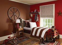 I like the brown and red walls.  I would like these colors in our downstairs family room !