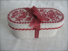site has several nicely finished boxes with needlework