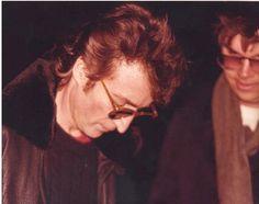 John Lennon signs Mark Chapman's copy of 'Double Fantasy' outside the Dakota…