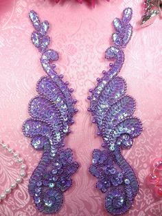 Mirror Pair Lavender AB Sequin Beaded Appliques    Measures: 8.5 x 2.5 each    You are buying a pair.    This applique pair is great for costumes