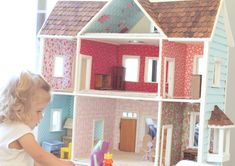 oh my. our dollhouse is so getting a makeover. scrapbook paper or fabric!