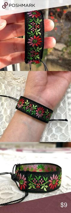 "๑Pink 'n' Red Floral Jacquard Trim Bracelet๑ 🔮10% DISCOUNT USING ""ADD TO BUNDLE"" BUTTON ⇨ Get a FREE Bracelet!  •Handmade by me!   •3/4 in. wide red, pink, & green on black floral pattern jacquard trim (100% polyester) Finished with a nylon thread closure knot for a secure fit. Lovely vintage style!  •ⓢⓘⓩⓔ: Adjustable knot (fits any size)…"