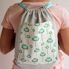 A simple sewing tutorial for this adorable kids drawstring backpack.
