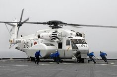 MH-53E Super Stallion helicopter from the Japan Maritime Self-Defense Force (JMSDF) Helicopter Mine Squadron 111 lands aboard the amphibious dock landing ship USS Tortuga (LSD 46)