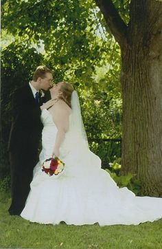 I love this romantic pic of our bride under the tree with her new husband!  She looks amazing!
