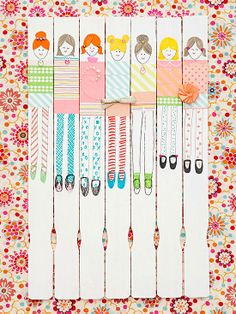 Washi tape and ribbons doll up paint sticks beautifully! Kids will have a blast creating their own twin.
