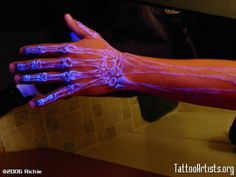 White ink tattoos glow under UV! (Do not like this tattoo though).