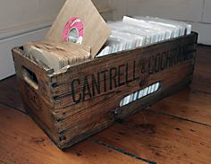 "Vintage Cantrell & Cochrane drink crate, 7"" record storage"