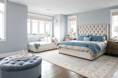 The gray and blue tones in this room make it a very mellow and relaxing master bedroom.