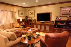 Traditional family room with comfortable conversation area and molding around the TV to match the shelving along the wall.