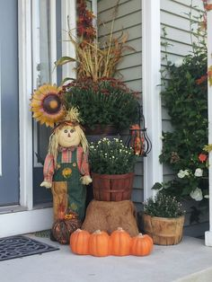 Fall porch decor... Love this idea...think it would be awesome with mums and pumkins and a scarecrow and some tall stalks of corn using the steps to provide different heights