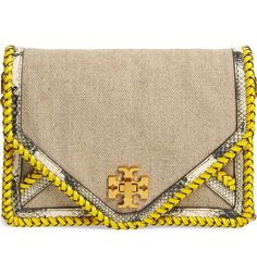 Vibrant whipstitched trim and metallic snake embossing enhance the mixed-media allure of this envelope crossbody bag fronted with gleaming Tory Burch hardware.