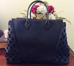 Louis Vuitton W Gm Black Satchel. Save 6% on the Louis Vuitton W Gm Black Satchel! This satchel is a top 10 member favorite on Tradesy. See how much you can save