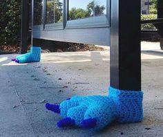 Yarn bombing  bus shelter blue monster feet