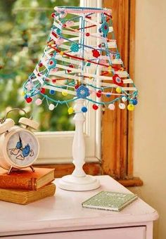 Having fun upcycling an old lampshade with ribbons and crochet and pom poms! Lampe Crochet, Crochet Lampshade, Lamp Shade Crafts, Home Crafts, Diy And Crafts, Lampshade Chandelier, Boho Lighting, Crochet Projects, Diy Projects