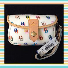 "Authentic Dooney&Bourke Multicolor Wristlet % AUTHENTIC ✨ This is very pretty & fun multicolor wristlet/clutch from Dooney&Bourke  In very good condition ✨ Length 6"" Height 3 3/4"" Width 1 1/2""  NO TRADE  Dooney & Bourke Bags Cosmetic Bags & Cases"