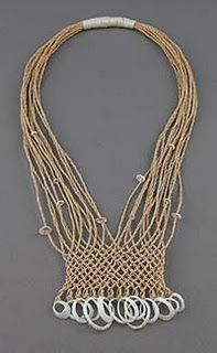 """Kay Sekimachi (b. 1926) is a fiber artist and weaver. Known as a """"weaver's weaver,"""" Sekimachi uses the loom to construct three-dimensional sculptural pieces. She attended the California College of Arts, where she studied with Trude Guermonprez, and at Haystack Mountain School of Crafts, where she studied with Jack Lenor Larsen."""