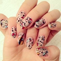 Don't know if they're supposed to, but these look like Joan Miro nails!