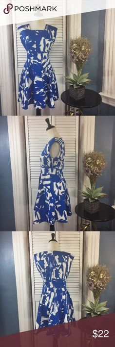 """IXIA Blue and White Skater Sleeveless Dress IXIA Blue and White Skater Sleeveless Dress. Girly and colorful. Square neckline. Fitted st waist. Skirt flares out. Zipper on back. No size and material information available. Approximate measurements (measured flat): bust: 17"""", waist: 14"""", length: 34"""". Excellent used condition. No signs of wear. IXIA Dresses"""