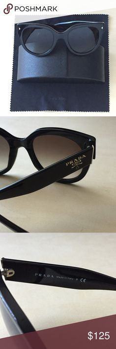 Prada Sunglasses Prada black sunglasses style SPR17O with gradient lenses and silver hardware. They have been gently used but are in great condition. There are small signs of wear throughout but no major damage. Includes original case and cleaner. Prada Accessories Sunglasses