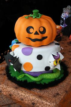 Halloween Cake... One of these days I will give cake decorating a try.  Wish fondant didn't taste so much like crap.
