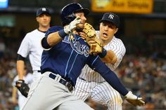 High tag -   Mark Teixeira #25 of the New York Yankees tags out Kevin Kiermaier #39 of the Tampa Bay Rays in the seventh inning at Yankee Stadium on July 3 in New York City. -    © Mike Stobe/Getty Images