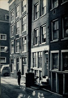 """1959. Zeedijk in Amsterdam. The Zeedijk (""""Sea dike"""") is a street in the old center of Amsterdam. The Zeedijk was originally constructed as a seawall to protect Amsterdam from the water of the IJ, which was in open connection with the Zuiderzee until 1872. The street is the northern and eastern boundary of De Wallen (red-light district) and runs between Prins Hendrikkade and Nieuwmarkt. #amsterdam #1959 #zeedijk"""