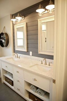 Love this gray shiplap bathroom from http://countryliving.com. The Rustic Collection has two shades of gray we think you'll love too! Sold exclusively at Lowe's.