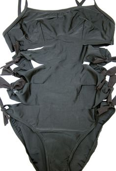 Step 7: Repeat on all sections and on the elastic of the bottom area.   4 DIY Ways To Transform Your Boring Old BathingSuit