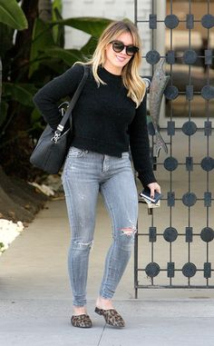 Retail therapy! The actress isall smiles in a black sweater and ripped jeans while shopping in Beverly Hills.