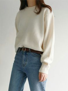 Fluffy white sweater with jeans a brown belt for a simple, yet classic outfit this fall/winter