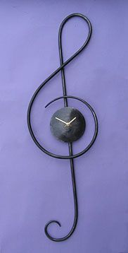 musical wall clock in the shape of a treble clef, a clock for a music room or concert hall