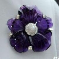 Princess Michael's Purple Flower Brooch The brooch is in form of a flower with five petals, with a diamond cluster in the middle and five pearls between the petals. It may be Kiki McDonough creation, although there is no confirmation Royal Jewelry, Vintage Jewelry, Purple Jewelry, Diamond Jewelry, Antique Jewelry, Heavy Metal, Crown Jewels, Flower Brooch, Purple Flowers