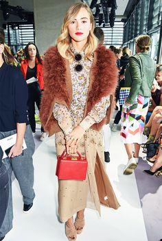 Suki Waterhouse wears a floral maxi dress, faux fur cardigan, nude platforms, and a red box bag