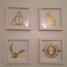 Gold nerdy home decor: metallic foil laminate deathly hallows, Felix felicis, golden snitch, time turner from Harry Potter, white shadow box frames, geek chic, use clear packing tape on back to seal for bathroom decor