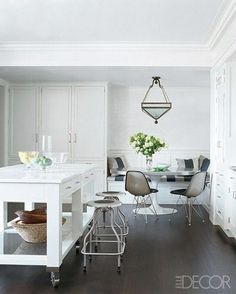 Love the tall cabinets and banquette