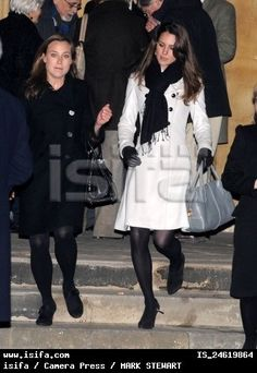 Kate Middleton attends a charity Christmas Carol Concert at St. Luke's Church, Chelsea, London on December 1, 2009. The concert is in aid of the Henry van Straubenzee Memorial Fund, of which Prince William and Prince Harry are patrons.
