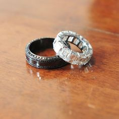 Wedding bands... A girl can dream for that one. I love the black with black diamonds for the husbands ring.