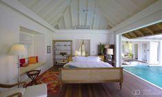 Bedroom with pool at Naladhu Maldives.