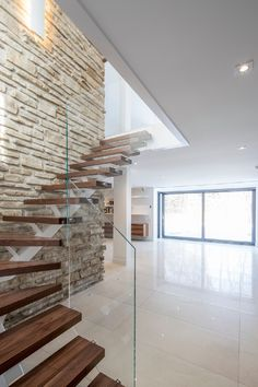 contemporary farmhouse wood and glass staircase with brick wall background