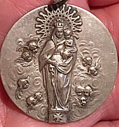 Large Antique Holy Medal Virgin Mary Child Jesus Angels (Image1)Gorgeous and detailed religious medal pendant featuring the Blessed Mother Virgin Mary and the Christ child Jesus surrounded by Victorian cherubs / angels. The large size is perfect for a man. 1.75 inches long entirely, 1.3/8 inch wide.